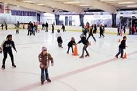 Patrons ice skating at the Herbet Well Ice Rink