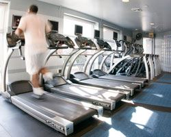 Man running on a treadmill in a fitness center